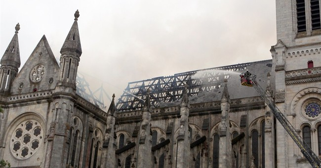 Fire torches historic basilica rooftop in western France