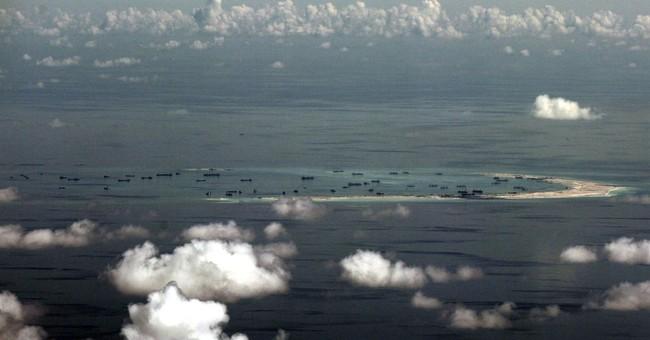 China says South China Sea island building to finish soon