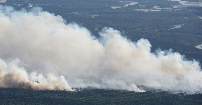 Alaska wildfire quickly grows, forces homes to evacuate
