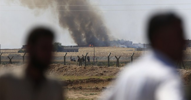 Kurdish fighters seize large parts of IS border stronghold