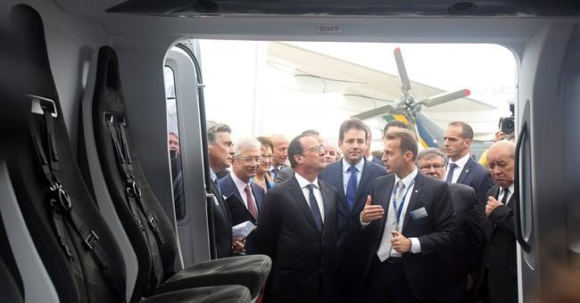 The Latest: Bombardier premiers CSeries jet at Paris show
