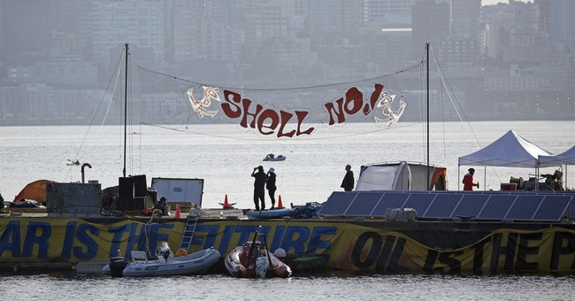 Kayak protesters detained after trying to stop Shell oil rig