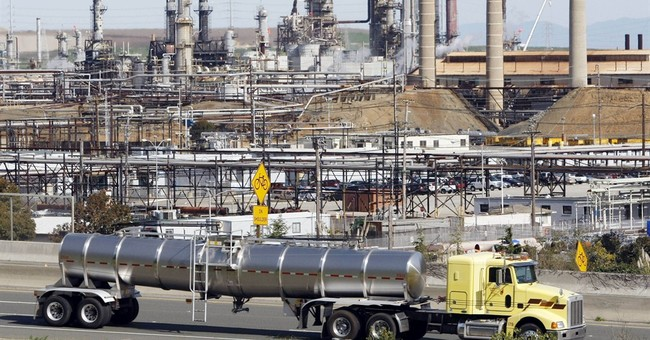 US factory output down in May, hurt by oil refining cuts
