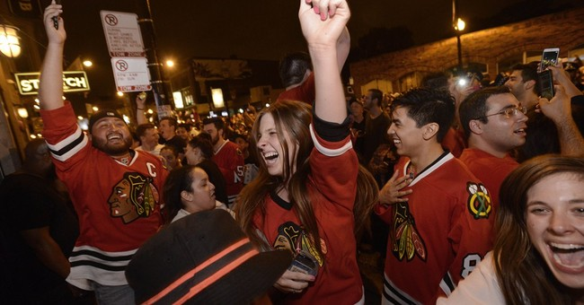 The Latest on Stanley Cup: Cup arrives at Wrigley Field