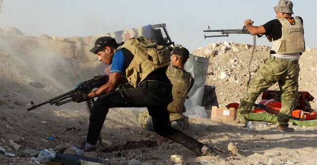 Islamic State group loses key town on Turkish border
