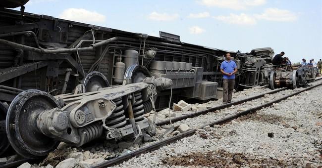Tunisian train hits truck blocking tracks, 18 dead
