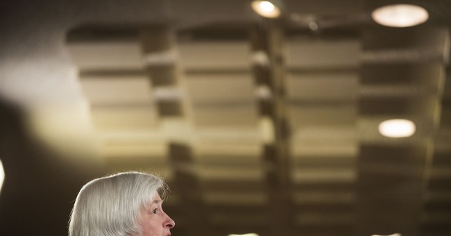 Fed expected to open door to rate hike if economy improves