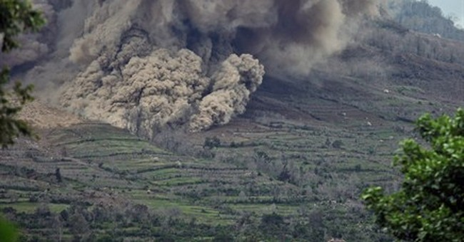 Thousands of Indonesians refuse to leave volcano danger zone