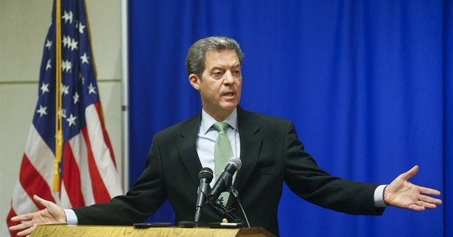 Kansas governor says deficit plan is not a tax increase
