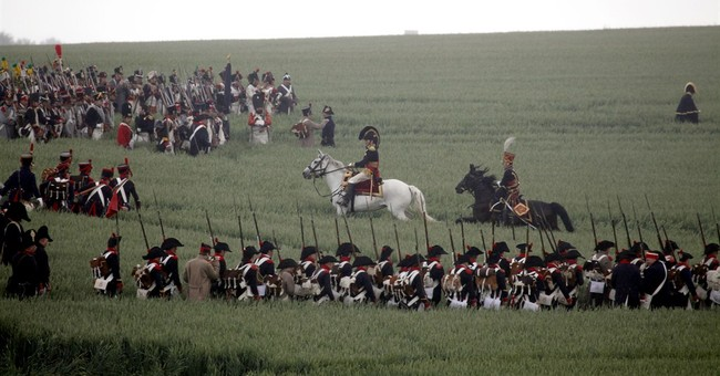 AP PHOTOS: Re-enactors mark Belgian-Dutch effort at Waterloo