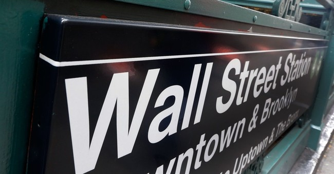 US stocks open slightly higher; Aetna gains in early trading