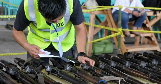 Filipino Muslim rebels lay down arms to reinforce peace deal