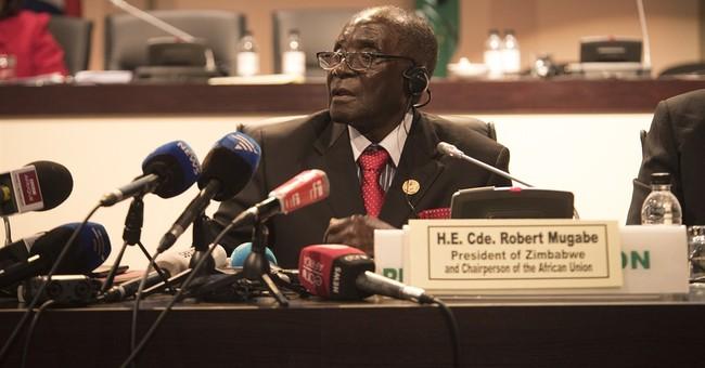 AU head Mugabe says international court unwelcome in Africa