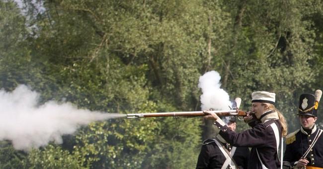 AP PHOTOS: Re-enactors mark Belgian-Dutch effort at Waterloo