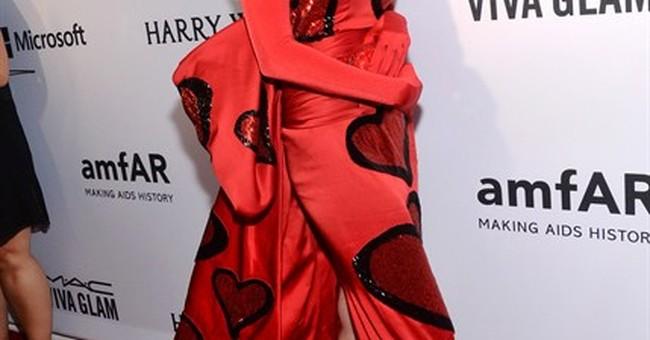 Miley Cyrus brings agender date to amfAR gala