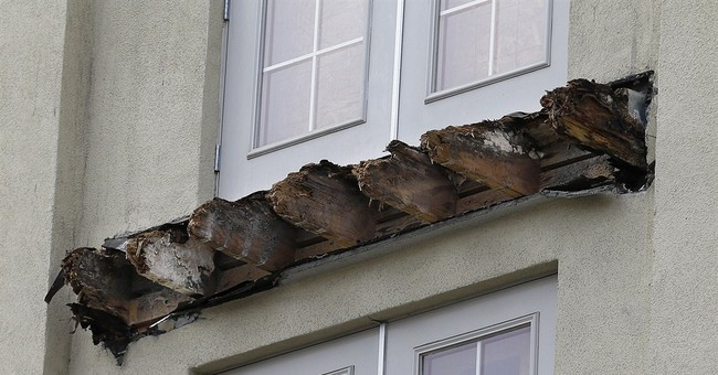 Deadly balcony collapse tied to rotted wooden beams