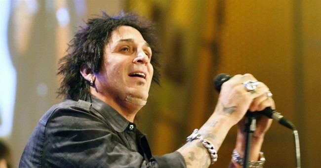 Journey drummer charged with domestic violence in Oregon