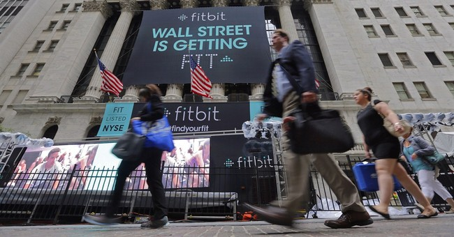 Fitbit shows off its pipes in NYSE debut as shares soar