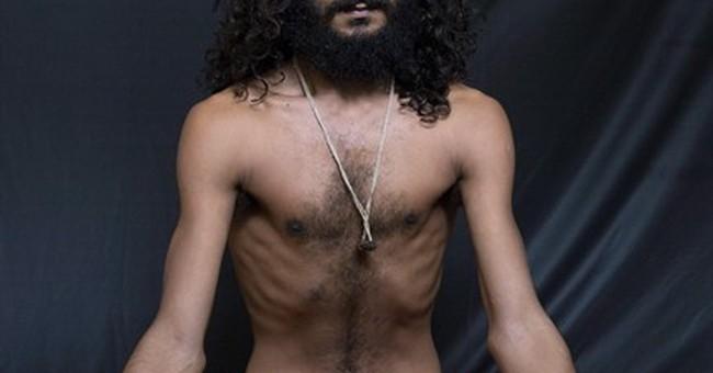 AP PHOTOS: Indian yogis twist bodies, soothe minds