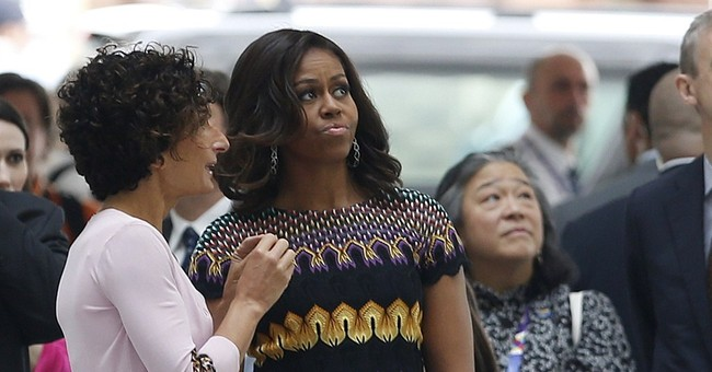 Michelle Obama lights candles for US shooting victims