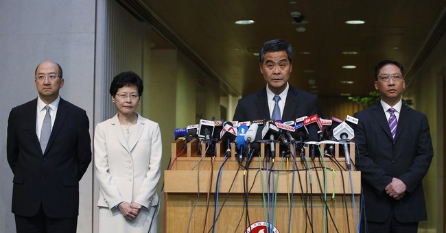Hong Kong lawmakers reject Beijing-backed election plan