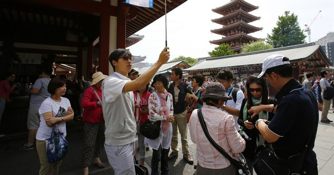 Japan's tourism boom lifts economy, but brings headaches