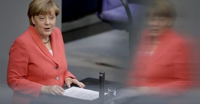 Merkel presses EU partners to share refugee burden
