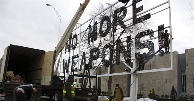 Mexican border city takes down anti-gun billboard