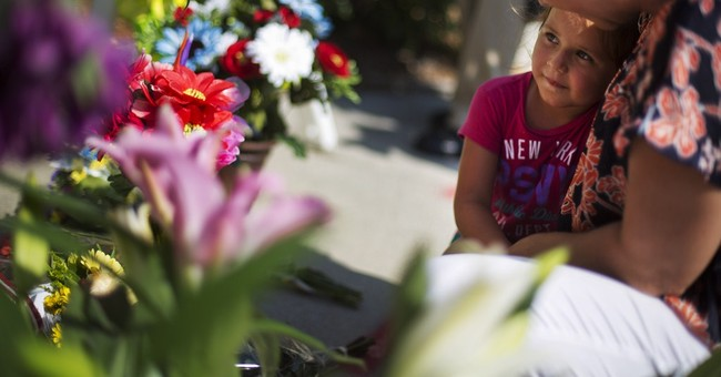 The latest on church shooting:  Survivor played dead