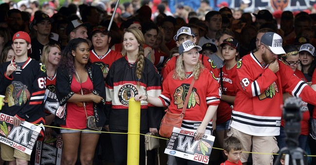 The Latest: Confetti ends Blackhawks' Stanley Cup rally