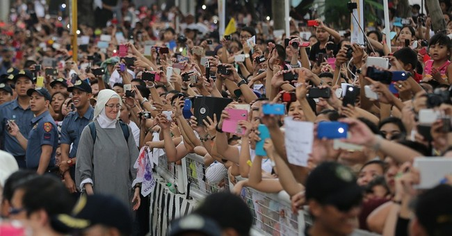 AP PHOTOS: Loving the pope, and taking his picture