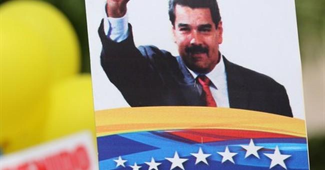Venezuela president receives parade amid looming crisis