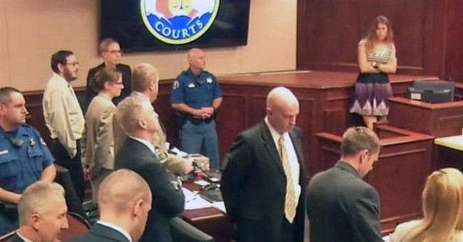 The Latest: Theater shooting judge denies motion to acquit