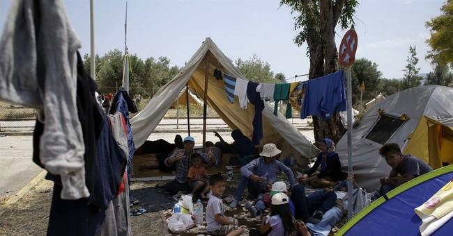 Greek island swamped by refugee flood; no relief in sight