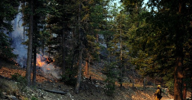Western wildfires: Flames fly through 3 hot, dry states