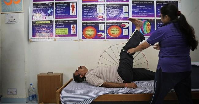 AP PHOTOS: Celebrating yoga across India