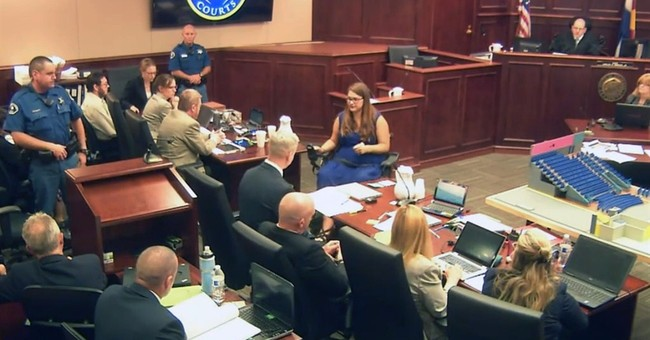 Theater shooting prosecutors rest after emotional case