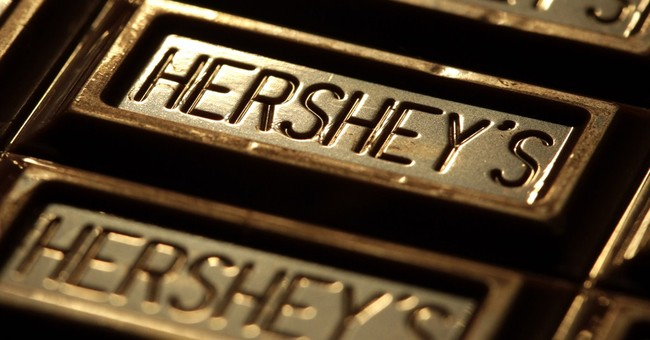 Hershey to cut about 300 jobs, lowers 2015 revenue outlook