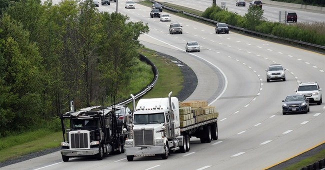 EPA proposes tougher mileage standards for trucks