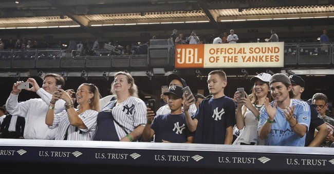 Fan with A-Rod's 3,000th ball holding onto it _ for now
