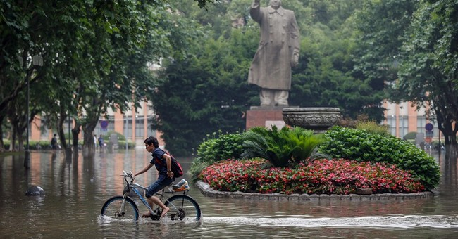 Heavy rains in southern China kill 18, leave 4 missing