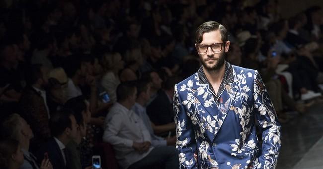 Tim Robbins takes in Emporio Armani as Fashion Week opens