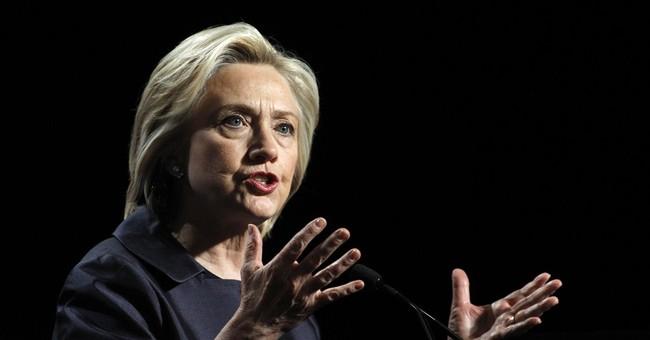Clinton calls for 'common-sense' gun control, decries racism