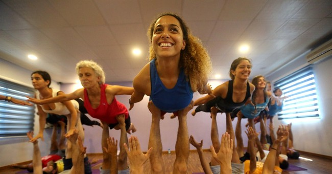 Millions worldwide take to their mats on Yoga Day