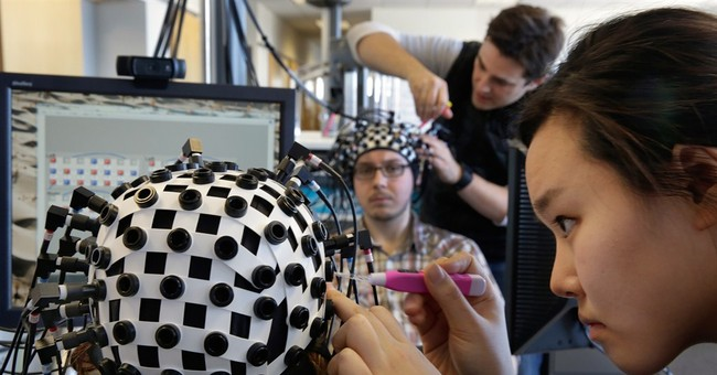 Lasers, magnetism allow glimpses of the human brain at work