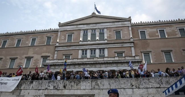 THE LATEST: Greeks march to show support for staying in euro