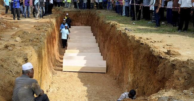 Malaysia buries Rohingya human-trafficking victims