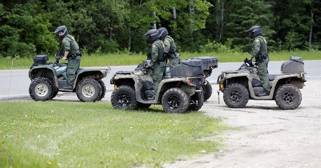 Searchers buoyed by fresh DNA comb woods for escaped inmates