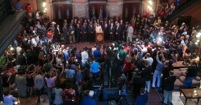 Latest on church shooting: Lawmaker backs Miss. flag change