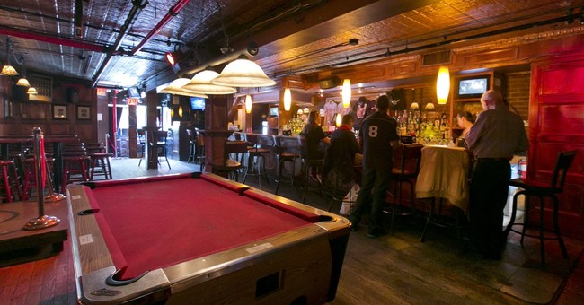 Stonewall Inn gets landmark status, a nod to LGBT history